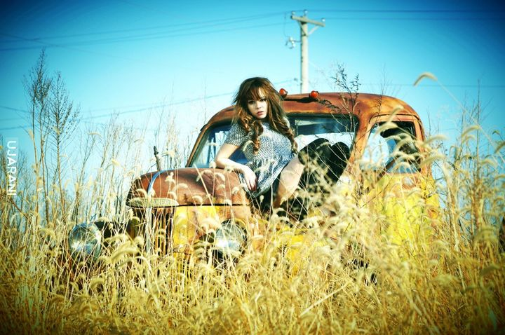 Young Girl and Old Cars