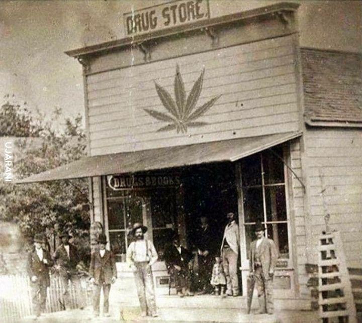 Chłopi stojący przed sklepem w 1880
